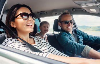 Excited family enjoying their car paid for by an auto loan