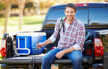 Man enjoying his pickup that he financed with a truck loan