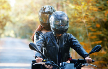 Couple enjoying their new motorcycle that they financed with a motorcycle loan