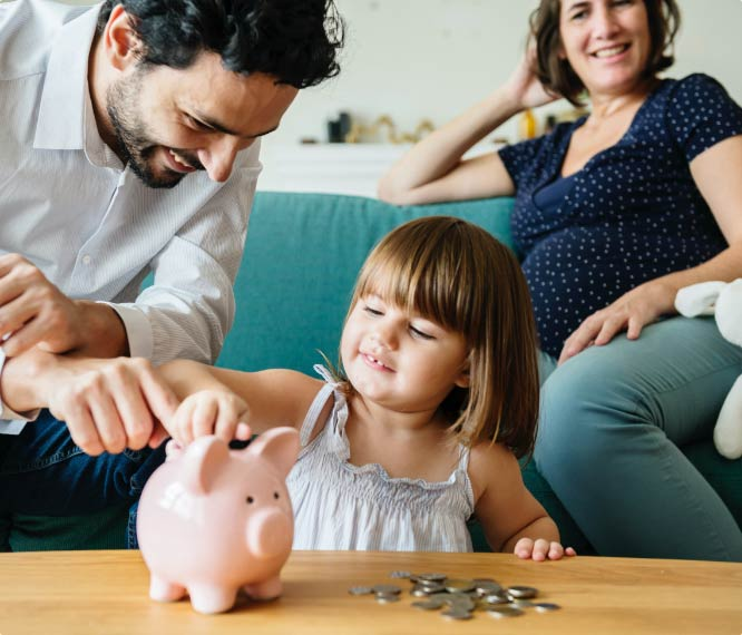 Parents teaching young daughter about starting a savings account